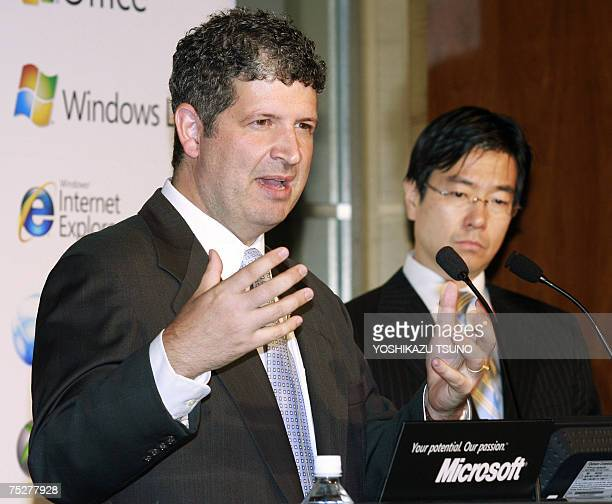 Microsoft Japan President Darren Huston and new COO Yasuyuki Higuchi the former Daiei supermarket chain president speaks before press in Tokyo 09...