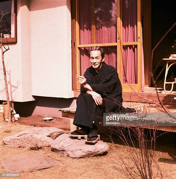 Nobel prize winner in physics, Shinichiro Tomonaga, age 56, seated on the porch of his Tokyo home. He is shown seated and smoking a cigarette. He won...