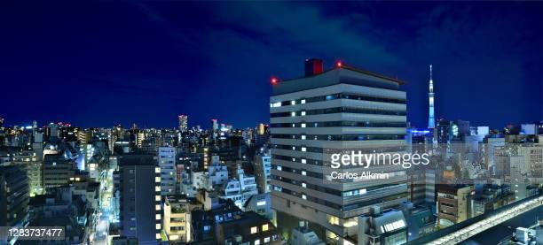 """tokyo, japan - panoramic skyline at night of asakusabashi and asakusa districts, with the iconic """"tokyo skytree"""" tower in the distance - carlos alkmin stock pictures, royalty-free photos & images"""