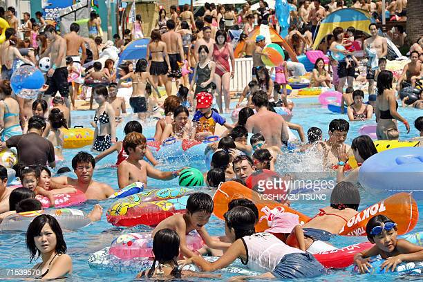 People try to cool off at a crowded swimming pool at the Toshimaen amusement park in Tokyo 30 July 2006 More than 10000 people visited the amusement...