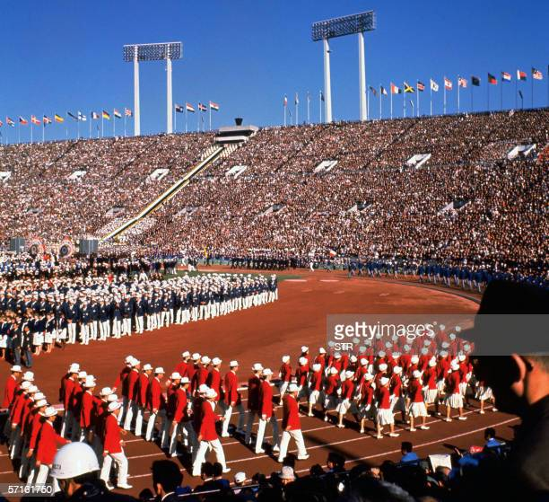 Photo taken 10 October 1964 shows the opening ceremony of Tokyo Olympic Games at Tokyo's national stadium Tokyo is making a head start bidding for...
