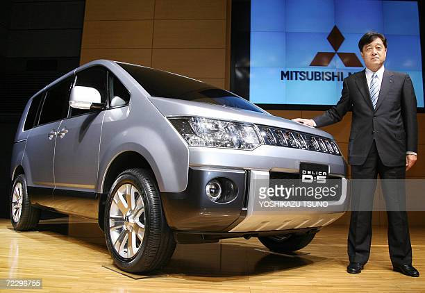 President of Japanese auto maker Mitsubishi Motors Osamu Masuko introduces the company's new minivan Delica D5 equipped with a 24litre engine at the...