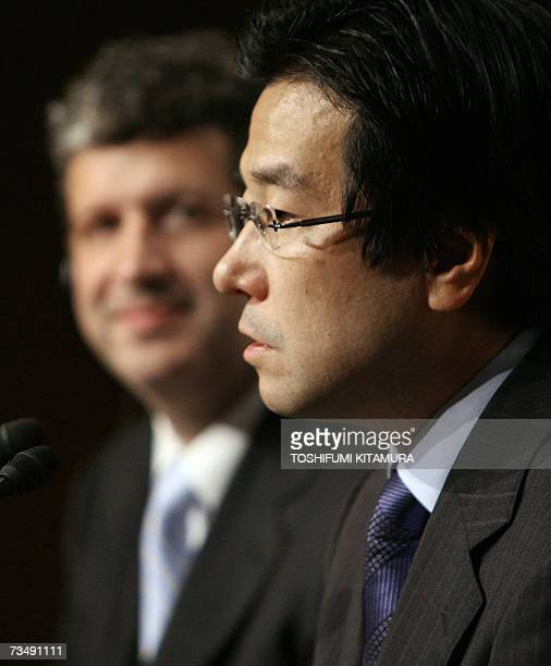 President of Microsoft K.K -the Japanese unit of the US computer giant-, Darren Huston looks at the company's new Chief Operating Officer Yasuyuki...