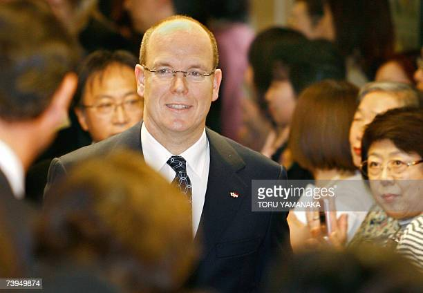 Prince Albert II of Monaco is welcomed by people upon his arrival at a department store to visit 'La Princesse Grace de Monaco' exhibition in Tokyo...