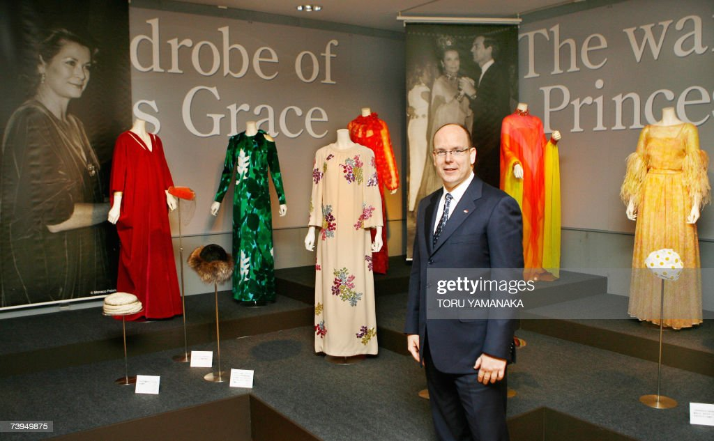 Prince Albert II of Monaco looks at dresses of his late mother, Princess Grace as he visits the 'La Princesse Grace de Monaco' exhibition in a Tokyo department store, 23 April 2007. Prince Albert is here on a three day visit to Japan. AFP PHOTO/Toru YAMANAKA