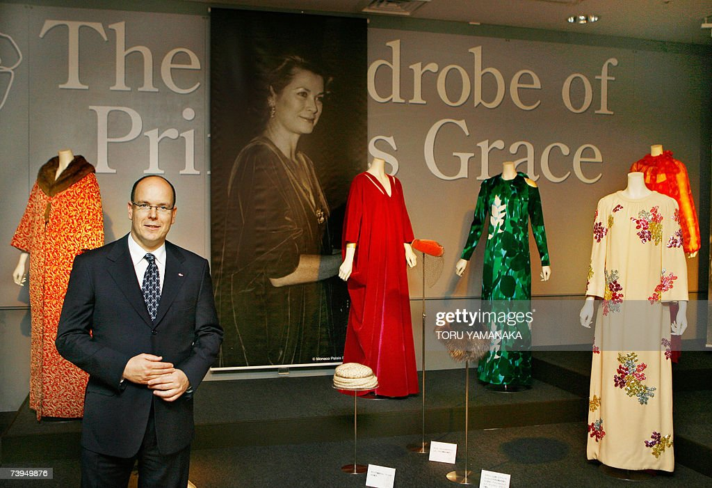 Prince Albert II of Monaco poses with dresses of his late mother, Princess Grace as he visits the 'La Princesse Grace de Monaco' exhibition in a Tokyo department store, 23 April 2007. Prince Albert is here on a three day visit to Japan. AFP PHOTO/Toru YAMANAKA