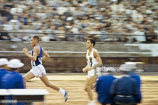 Ron Clarke Olympic Track star passed by Bill Mills who won in the 10000 meter run