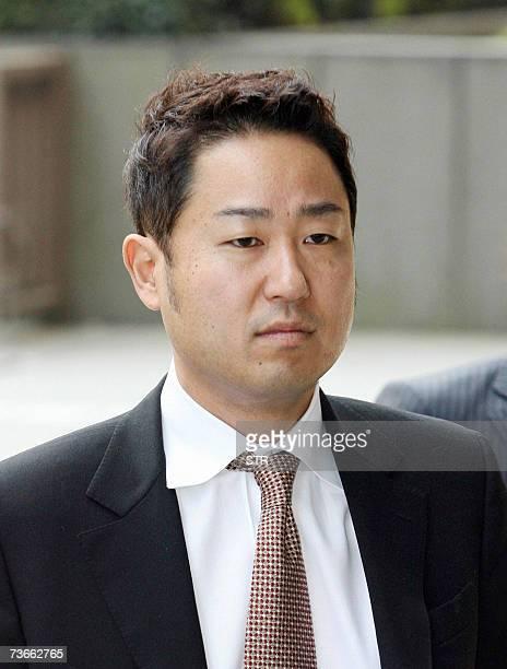 Ryoji Miyauchi former executive of Japan's Internet giant Livedoor enters the Tokyo District Court 22 march 2007 Miyauchi was sentenced to 20 months...