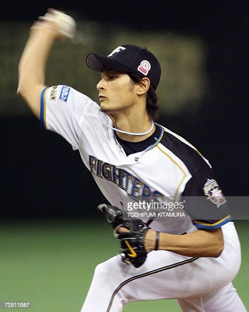 Starter of the Nippon Ham Fighters Yu Darvish throws a pitch during the second inning of the Konami Cup Asia Series 2006 baseball tournament final...