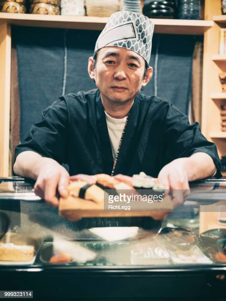 tokyo japan sushi chef - sushi restaurant stock photos and pictures