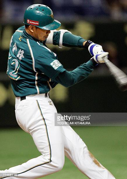 Taiwan's baseball team, La New Bears slugger Chin-Feng Chen bats for a grand slam homerun during the fifth inning of their match against China Stars...