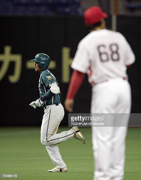 Taiwan's baseball team, La New Bears slugger Chin-Feng Chen runs after his grand slam homerun in the fifth inning of the match against China Stars in...