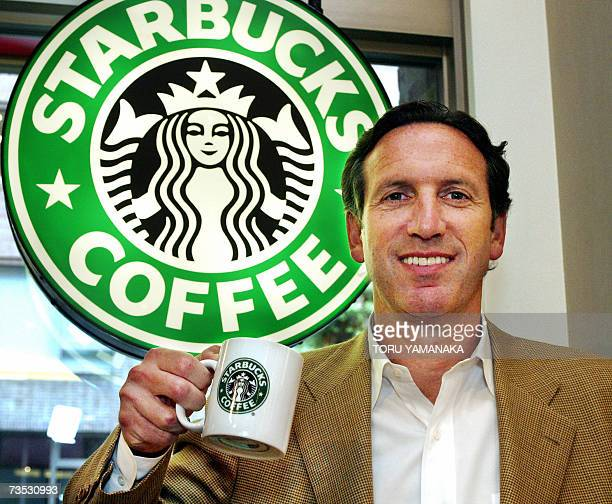 TO GO WITH AFP STORY FILES Picture taken 26 June 2002 shows American coffee chain giant Starbucks Chairman Howard Schultz posing at his coffee shop...