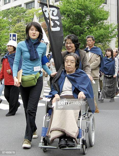 TO GO WITH JAPANENVIRONMENTPOLLUTIONMINAMATA Minamata disease patients and their supporters march near the Environment Ministry in downtown Tokyo 29...