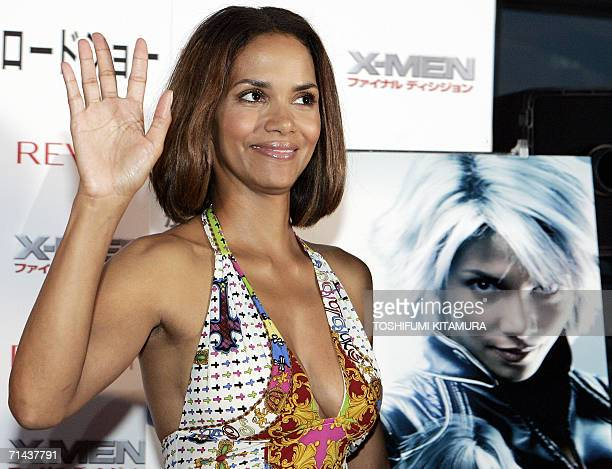 US actress Halle Berry waves upon her red carpet arrival for the XMen The Last Stand premier night special party in Tokyo 14 July 2006 Some 50 guests...