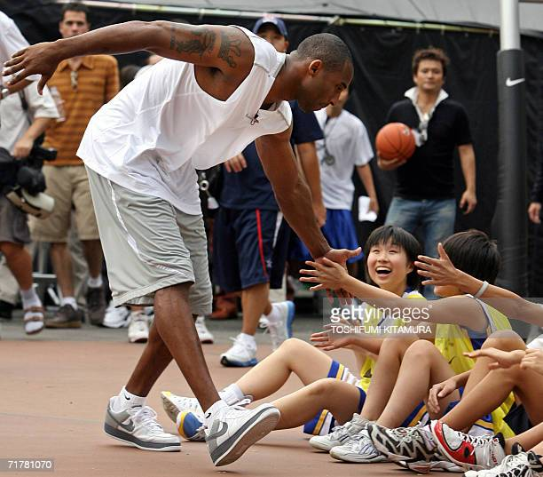 """S Los Angeles Lakers star shooting guard Kobe Bryant greets junior basketball players upon his arrival for his basketball clinic, """"Kobe81 Asia Tour..."""