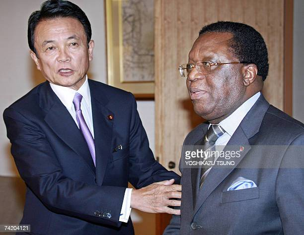 Visiting Ivory Coast Foreign Minister Youssouf Bakayoko is greeted by his Japanese counterpart Taro Aso for their talks at Aso's office in Tokyo 21...