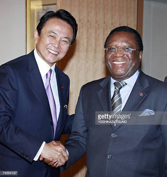 Visiting Ivory Coast Foreign Minister Youssouf Bakayoko shakes hands with his Japanese counterpart Taro Aso before their talks at Aso's office in...