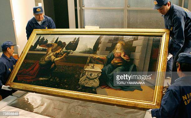 Workers of a Japanese transportation company carry Leonardo da Vinci's The Annunciation at the National Museum in Tokyo 16 March 2007 The masterpiece...