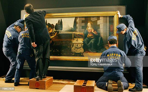 Workers of a Japanese transportation company place Leonardo da Vinci's The Annunciation on a wall at the National Museum in Tokyo 16 March 2007 The...
