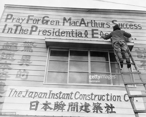 3/15/1948 Tokyo Japan Writer changes allegiance Painter puts finishing touches to sign on the front of a downtown Tokyo construction firm office...