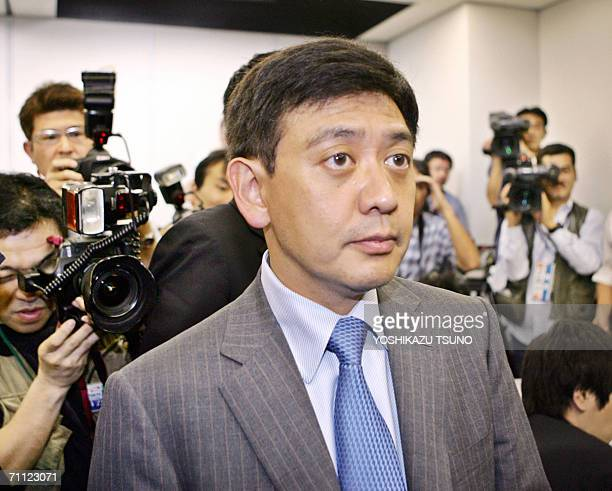 Yoshiaki Murakami a highprofile Japanese fund manager leaves a press conference at the Tokyo Stock Exchange 05 June 2006 where he admits to insider...