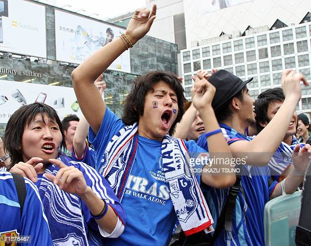 Young Japanese football fans sing songs to cheer for their team after Japan was defeated by Brazil at the FIFA World Cup 2006 at downtown Tokyo 23...