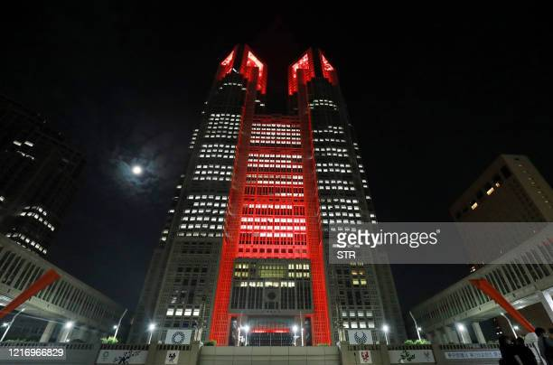Tokyo Metropolitan Government building is lit up in red after Tokyo government decided to issue an alert due to an increase in COVID19 coronavirus...