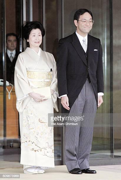 Tokyo metropolitan government worker Yoshiki Kuroda who will marry Japanese Princess Sayako daughter of Emperor Akihito smiles with his mother Sumiko...