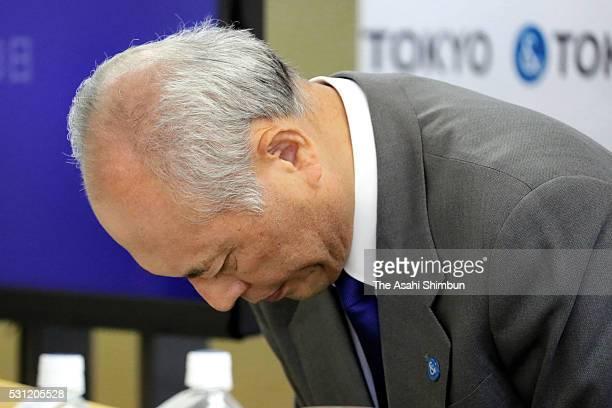 Tokyo Metropolitan Governor Yoichi Masuzoe bows during a press conference at the Tokyo Metropolitan Government headquarters on May 13 2016 in Tokyo...