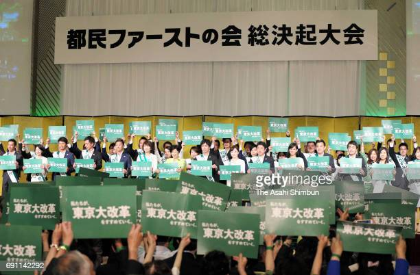 Tokyo Metropolitan Governor Yuriko Koike and election candidates hold posters during the local party 'Tokyo Citizen First' meeting on June 1 2017 in...