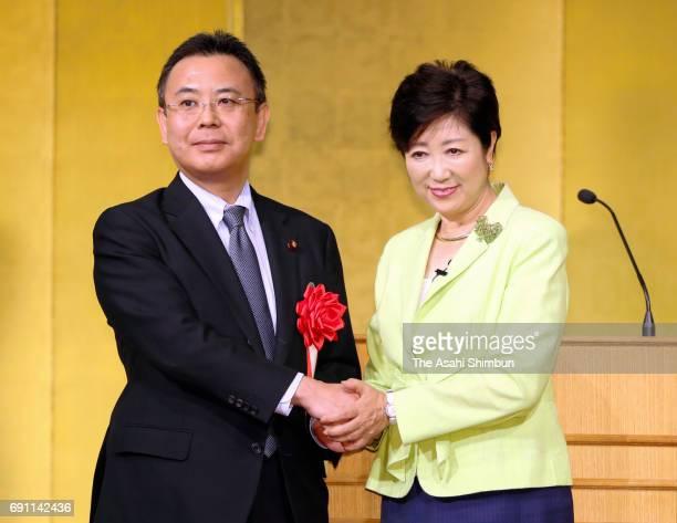 Tokyo Metropolitan Governor Yuriko Koike and Komeito Tokyo Chief Yosuke takagi shake hands during the local party 'Tokyo Citizen First' meeting on...