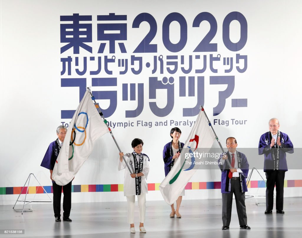 Tokyo Metropolitan Governor Yuriko Koike and Tokyo 2020 Organising Committee Director General Toshiro Muto wave the Olympic and Paralympic flags during the ceremony marking the three years to go to the Tokyo Summer Olympic Games at the Tokyo Metropolitan headquarters on July 24, 2017 in Tokyo, Japan.