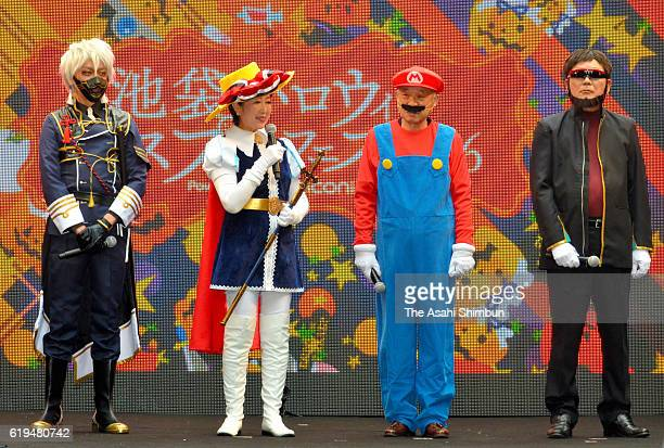 Tokyo Metropolitan Governor Yuriko Koike wearing a costume of the Princess Knight and Toshima Ward Chief Yukio Takano as Mario attend a Halloween...