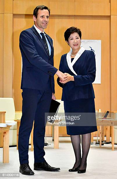 Tokyo Metropolitan Govorner Yuriko Koike and World Rowing Federation President JeanChristophe Rolland shake hands prior to their meeting at the Tokyo...
