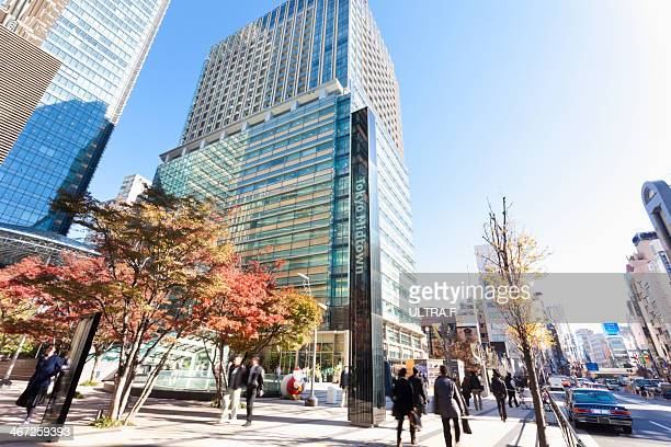 tokyo midtown and busy street - tokyo midtown stock pictures, royalty-free photos & images