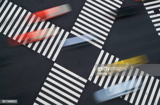 Tokyo. Multi colored taxis crossing zebra lines at Ginza.