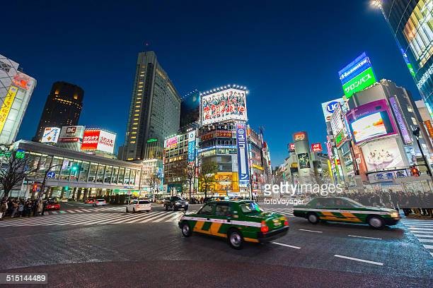 Tokyo neon night illuminated crowds traffic in futuristic cityscape Japan