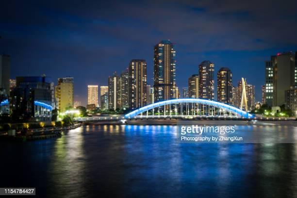 tokyo night at summer. chuo ward, japan. - 永代橋 ストックフォトと画像