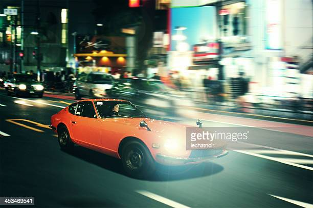 tokyo nightrace in an oldtimer sportscar - chasing stock pictures, royalty-free photos & images