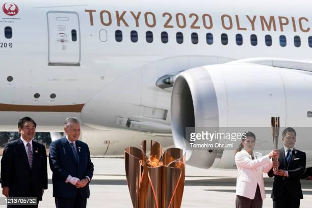 Tokyo Olympic and Paralympic Organizing Committee President Yoshiro Mori looks on as Olympic gold medalists Tadahiro Nomura and Saori Yoshida hold...