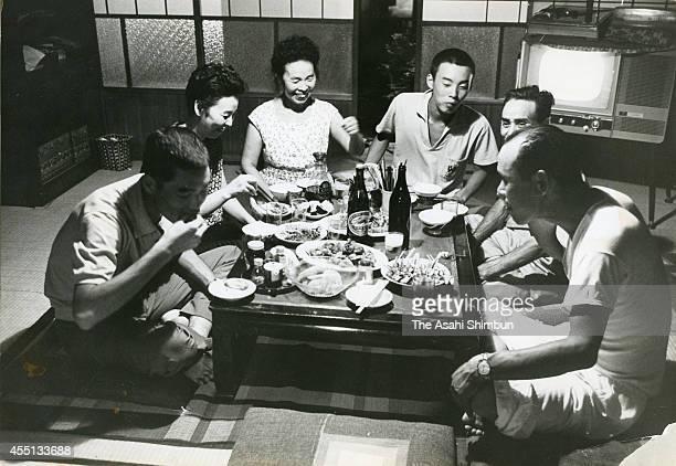 Tokyo Olympic final torch runner Yoshinori Sakai have dinner with his family at his home on August 28 1964 in Miyoshi Hiroshima Japan Sakai born in...