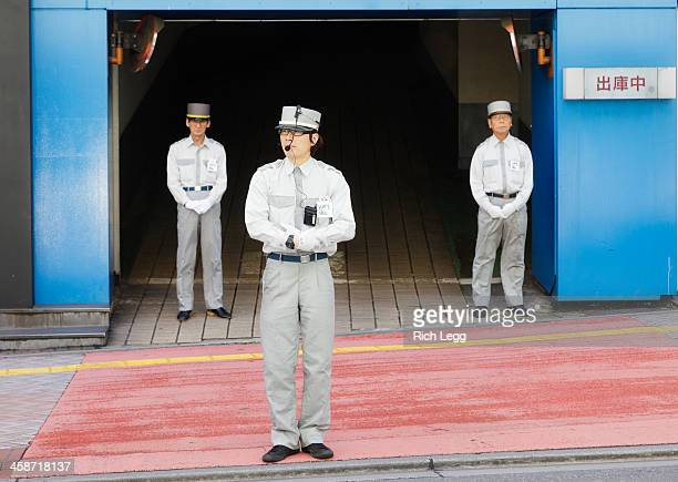 tokyo parking attendants - parking valet stock photos and pictures