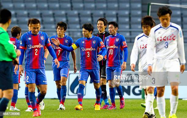 FC Tokyo players celebrate their 10 win in the JLeague match between FC Tokyo and Ventforet Kofu at Ajinomoto Stadium on April 4 2015 in Chofu Tokyo...