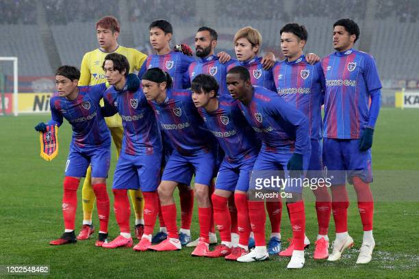 Tokyo players line up for the team photos prior to the AFC Champions League play off between FC Tokyo and Ceres-Negros at Tokyo Stadium on January...
