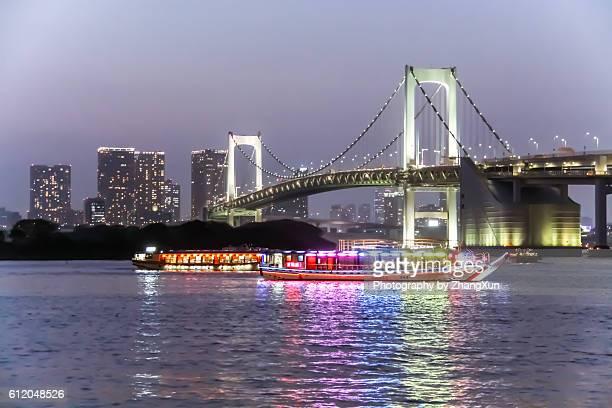 Tokyo Rainbow Bridge and Tokyo Bay with cityscape.
