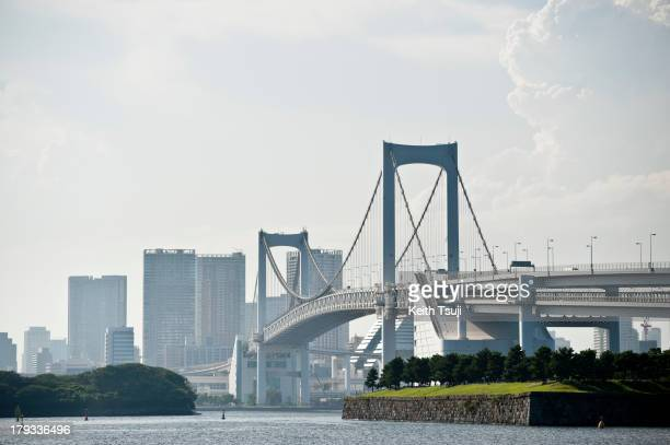 Tokyo Rainbow Bridge with commercial buildings in the background on September 1 2013 in Tokyo Japan The 798 meter long bridge connects Tokyo with the...