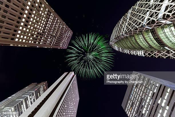 Tokyo Shinjuku night view with fireworks, Japan.
