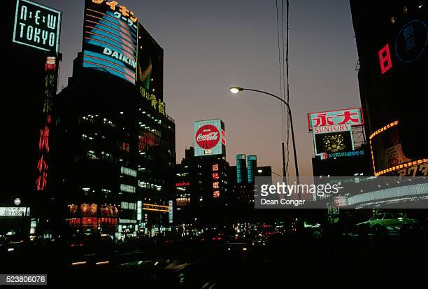 tokyo shopping district lit up at night - showa period stock pictures, royalty-free photos & images