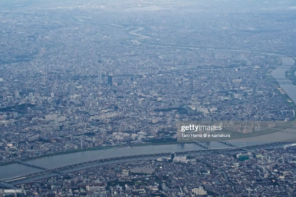 Tokyo Sky Tree and Arakawa River in Tokyo in Japan daytime aerial view from airplane : Stock-Foto